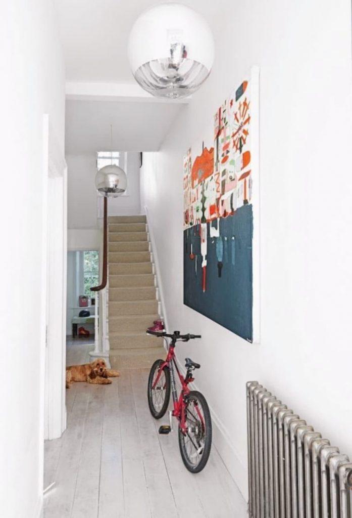 hallway with a bike and stylish print
