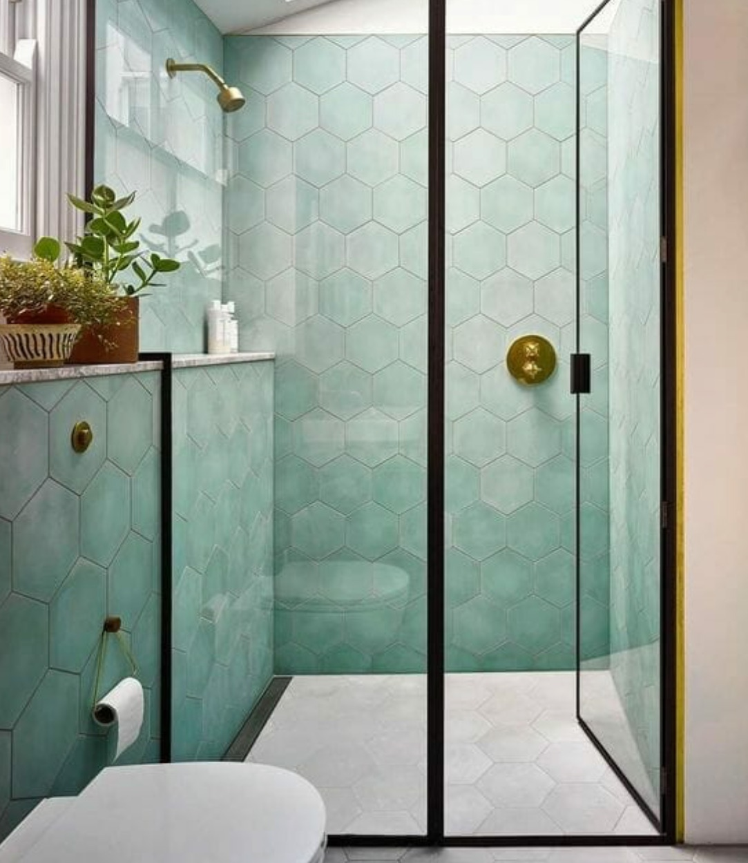 bathroom with teal tiles